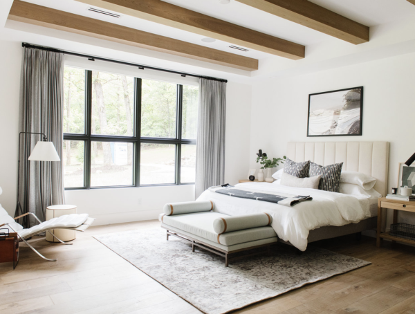bedroom with wood beams